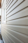 Wall finished in vinyl siding — Stock Photo