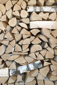 Birch logs are stacked in woodpile — Stock Photo