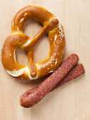 Pretzel and sausage — Stock Photo
