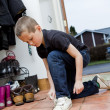Little Boy tying his shoes — Stock Photo #4175715