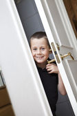 Little Boy by the door — Stock Photo