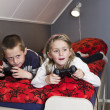 Siblings playing Video Games — Stock Photo #4271897