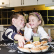 Siblings eating sweets — Stock Photo