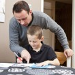Father helping son with homework — Stock Photo #4272122