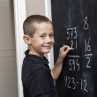 Young Boy in front of the blackboard — Stock Photo #4272133