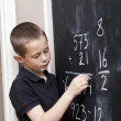 Young Boy in front of the blackboard — Stock Photo #4272137