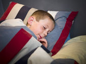 Young Boy sleeping — Stockfoto