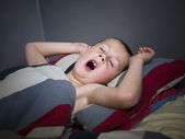 Young Boy yawning — Stock Photo