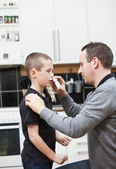 Father giving son Nose Drops — Stock Photo