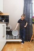Young Boy by the Dishwasher — Stock Photo