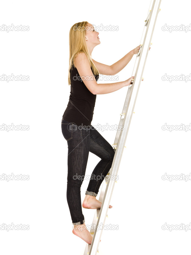 Woman climbing up the ladder isolated on white background  Stock Photo #4277626