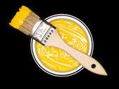 Może żółtej farby i pędzel — Zdjęcie stockowe