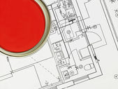Red Paintcan and Blueprint — Stock Photo