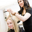 Hairdresser and customer — Stock Photo