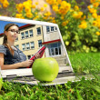 Laptop with female student on screen — Stock Photo