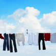 Clothesline and blue sky - Stock Photo