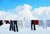 Clothesline and blue sky — Stock Photo