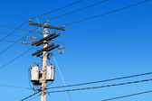 Power line post and blue sky — Stock Photo