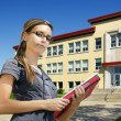 Student in front of school entrance — Stock Photo #4252330