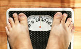 Obese feet on scale — Stock Photo