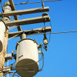 Stock Photo: Electricity transformers and sky
