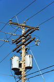 Electrical post and transformers — Stock Photo
