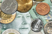 Money face and coins — Stock Photo