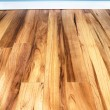 Wood floor and blue wal - Stock Photo