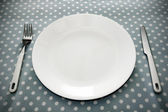 Place setting white plate and grey polka dot — Stock Photo