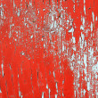 Red paint peeling - Stock Photo