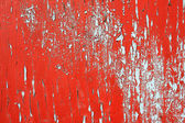 Red paint peeling — Stock Photo