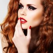 Beautiful woman model with luxury make-up and curly red hair - Stock Photo