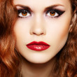 Foto Stock: Beautiful woman model with luxury make-up and curly red hair