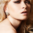 Luxury woman model with diamond earrings and blond hair — Stock Photo