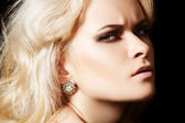 Chic fashion frown model with diamond jewelry, blond hair — Stock Photo