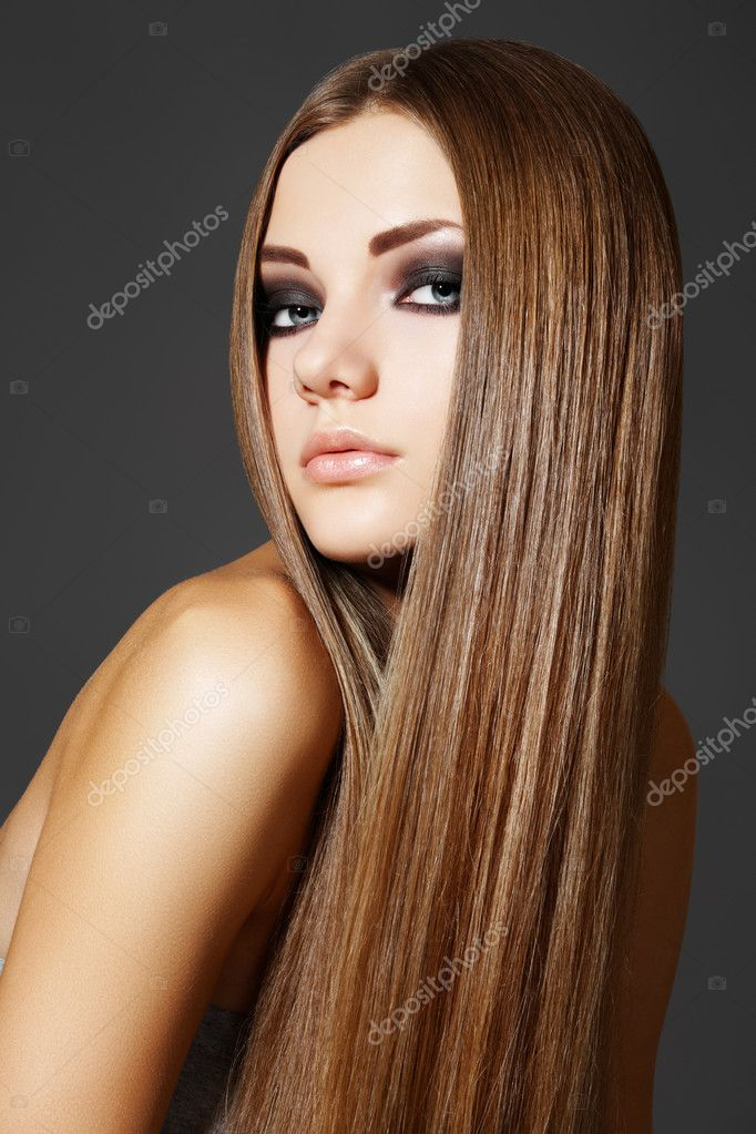 Wellness. Portrait of woman model with shiny long brown hair.   #4106409