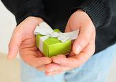 Man holding small present — Stock Photo