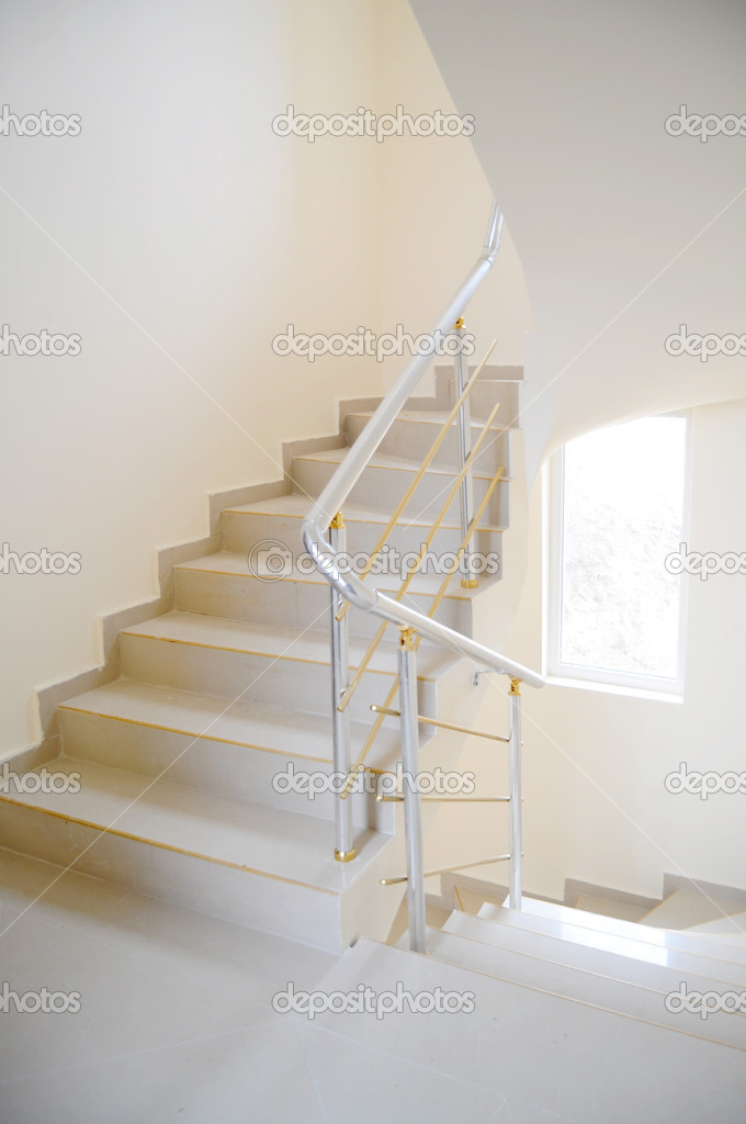 Staircase in modern building with metal handrail — Stock Photo #5371606