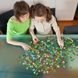 Stock Photo: Girl and mom doing puzzle