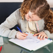 Girl doing homework - Stock Photo