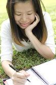 Girl writing — Foto de Stock
