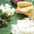 Indian cuisine banana leaf — Stock Photo
