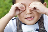 Boy covering eyes — Stock Photo