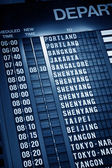 Timetable in airport — Stock Photo