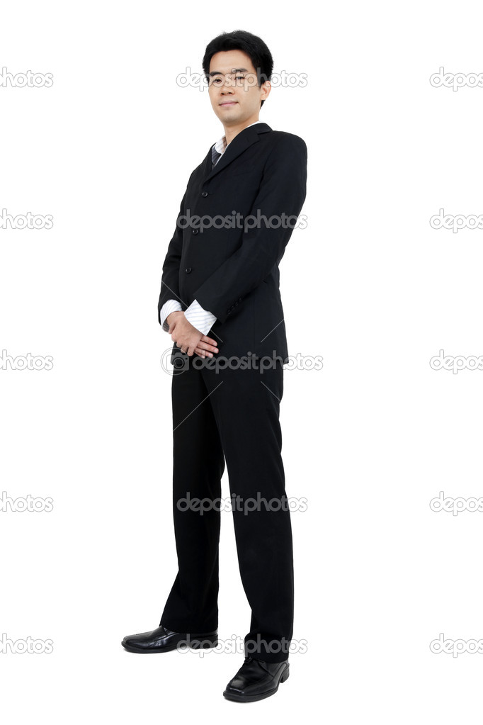 Full body of a smiling young Asian executive standing against isolated white background — Stock Photo #5190513