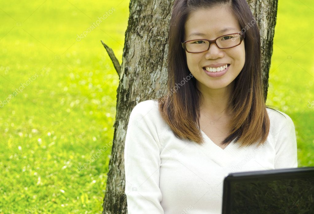 Asian Student Using Laptop Outside School Campus — Stock Photo #5238444