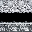 Stock Photo: Decorative lace with pattern on black background