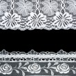 Decorative lace with pattern on black background — Stock Photo