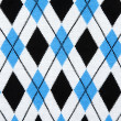 Background from knitted plaid fabrics — Stock Photo