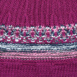 Stock Photo: Background from knitted violet fabrics